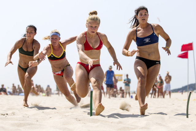 """The National parks department hosts the 30th annual """"All-Women Lifeguard Tournament"""" in Sandy Hook NJ. July 30, 2014. (Photo by Anthony Causi)"""