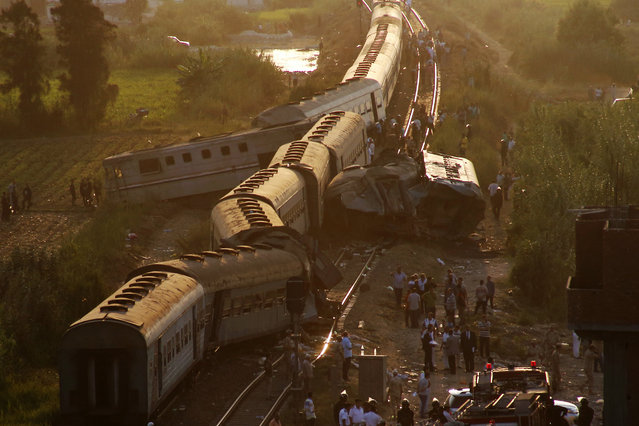 Two trains are seen after they collided just outside Egypt's Mediterranean port city of Alexandria, Friday, August 11, 2017, killing at least dozens of people and injuring over 100 in the country's deadliest rail accident in more than a decade. (Photo by Ravy Shaker/AP Photo)