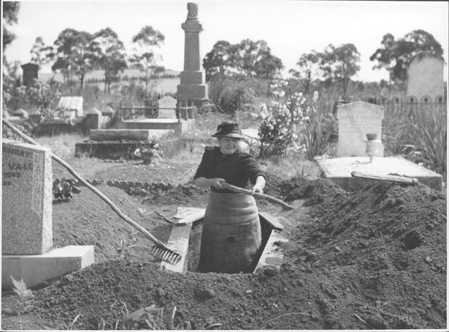 Josephine Smith digging a grave at the Drouin Cemetery, Victoria, ca. 1944. Meet Mrs. Josephine Smith, aged 84, whose hobby is digging graves. She lives in Drouin, a typical little farming town (1100 people), in southern Australia, 60 miles out of the Victorian capital, Melbourne