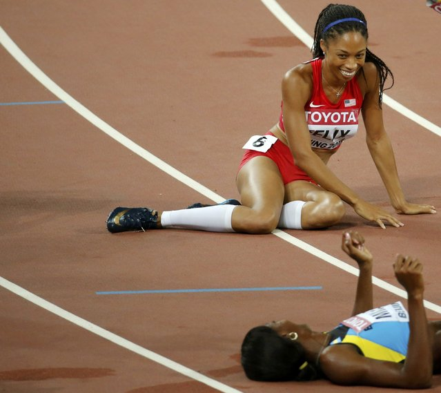 Allyson Felix of the U.S. (top) looks at Shaunae Miller of Bahamas after winning the women's 400m final during the 15th IAAF World Championships at the National Stadium in Beijing, China, August 27, 2015. (Photo by Fabrizio Bensch/Reuters)