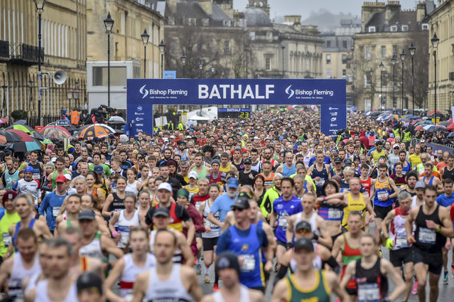 Runners at the start of the race during the Bath Half Marathon in Bath, England, Sunday, March 15, 2020. Despite coronavirus concerns, the half marathon has not been cancelled. For most people, the new coronavirus causes only mild or moderate symptoms. For some it can cause more severe illness, especially in older adults and people with existing health problems. (Photo by Ben Birchall/PA Wire via AP Photo)