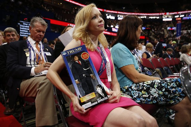 Florida delegate Dana Dougherty holds a Donald Trump doll on the floor during the first day of the 2016 Republican National Convention at Quicken Loans Arena in Cleveland, Ohio, USA, 18 July 2016. The four-day convention is expected to end with Donald Trump formally accepting the nomination of the Republican Party as their presidential candidate in the 2016 election. (Photo by Michael Reynolds/EPA)