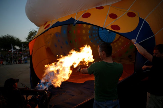 A hot air balloon is prepared for a flight during a two-day international hot air balloon festival in Eshkol Park near the southern city of Netivot, Israel July 22, 2016. (Photo by Amir Cohen/Reuters)