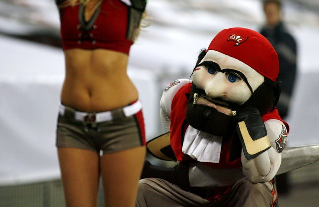 October 25, 2009; London,UK; The mascot for the Tampa Bay Buccaneers watches a cheerleader during the NFL International Series game against the New England Patriots at Wembley Stadium. (Photo by David Wilkinson/Offside Sports)