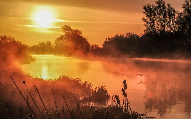 Sunrise in Ely, Cambridgeshire on April 15, 2020 by the River Great Ouse, England. The warm weather is set to continue until the weekend. (Photo by Veronica Johansson Poultney/Bav Media)