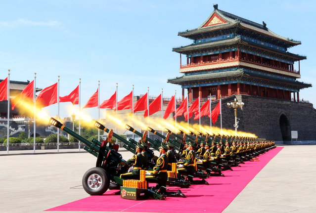 Military soldiers shoot salute guns to mark the opening of military parade at Tiananmen Square on September 3, 2015 in Beijing, China. China is marking the 70th anniversary of the end of World War II and its role in defeating Japan with a new national holiday and a military parade in Beijing. (Photo by ChinaFotoPress/ChinaFotoPress via Getty Images)