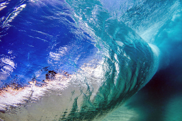 A wave from underneath. (Photo by Kenji Croman/Caters News)