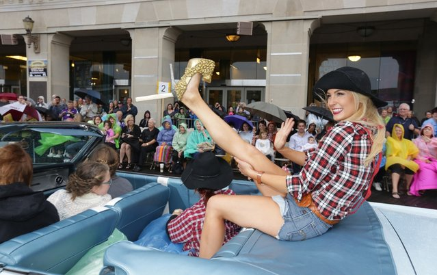 "Miss California Bree Morse waves during the 2016 Miss America pageant ""Show Us Your Shoes"" parade Saturday, September 12, 2015, in Atlantic City, N.J. (Photo by Michael Ein/The Press of Atlantic City via AP Photo)"