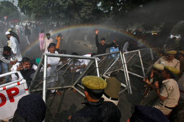 A rainbow forms as police use water cannon to disperse demonstrators during a protest, organised by India's main opposition Congress party, to mark a year since demonetisation was implemented by Prime Minister Narendra Modi, in Chandigarh, India November 8, 2017. (Photo by Ajay Verma/Reuters)