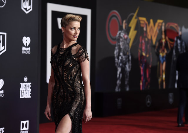"Amber Heard, a cast member in ""Justice League"", poses on the red carpet at the premiere of the film at the Dolby Theatre on Monday, November 13, 2017, in Los Angeles. (Photo by Chris Pizzello/Invision/AP Photo)"