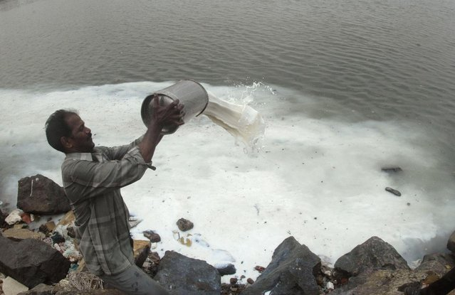 A government worker pours adulterated milk into the Kuvam river in Chennai July 24, 2008. (Photo by Reuters/Babu)