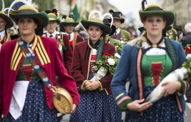 Women dressed in traditional Bavarian clothes take part in the Oktoberfest parade in Munich, Germany, September 20, 2015. (Photo by Lukas Barth/Reuters)