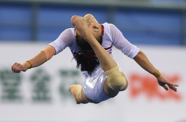 China's Chen Siyi performs in the floor exercise during the women's qualification round at the Gymnastics World Championships in Nanning, in China's southern Guangxi province on October 6, 2014. (Photo by Greg Baker/AFP Photo)