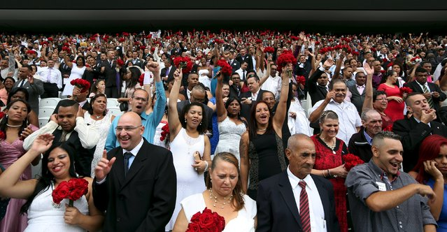Couples attend a mass wedding ceremony at Arena Corinthians soccer stadium in Sao Paulo, Brazil, September 26, 2015. (Photo by Paulo Whitaker/Reuters)
