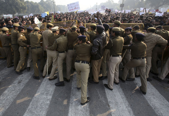 Police try to stop demonstrators near the presidential palace during a protest rally in New Delhi, on December 22, 2012. (Photo by Adnan Abidi/Reuters)