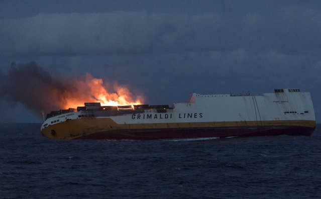 This photo provided on Thursday March 14, 2019 by the Marine Nationale, shows the Grimaldi vessel Grande America on fire in the Bay of Biscay, off the west coast of France, Monday March 11, 2019. French authorities are working to contain an oil spill off the Atlantic Coast after the Italian tanker sank following a fire. French and British rescue teams saved all 27 people aboard the Grande America tanker after it sank Tuesday. (Photo by Loic Bernardin/Marine Nationale via AP Photo)