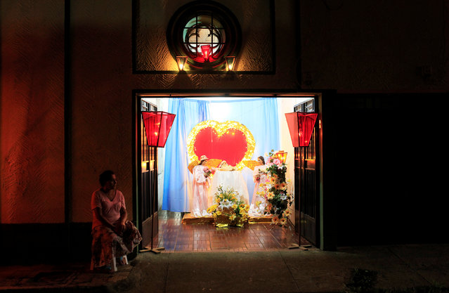 A woman sits next to an altar during the Lantern Festival celebrating the eve of the nativity of the Virgin Mary in Ahuchapan, El Salvador September 7, 2016. (Photo by Jose Cabezas/Reuters)