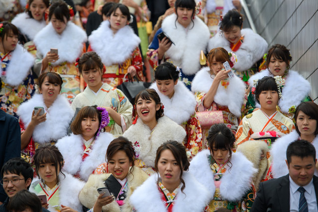 Women wearing kimonos leave after attending a Coming of Age ceremony on January 8, 2018 in Yokohama, Japan. (Photo by Carl Court/Getty Images)