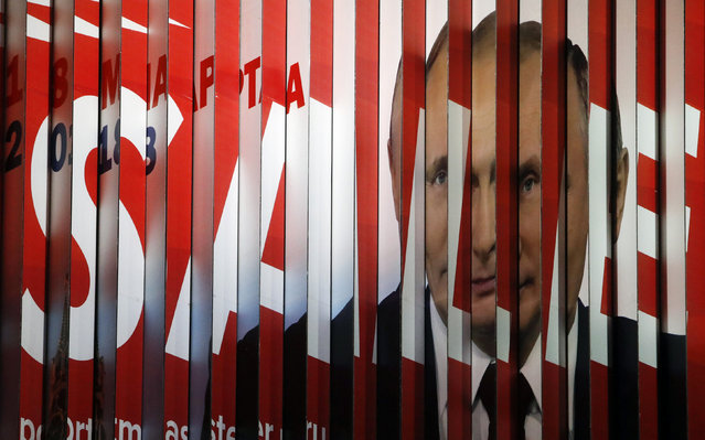 A multi-sided transformable board, which advertises the campaign of Russian President Vladimir Putin ahead of the upcoming presidential election, is on display in a street in Moscow, Russia January 15, 2018. (Photo by Sergei Karpukhin/Reuters)