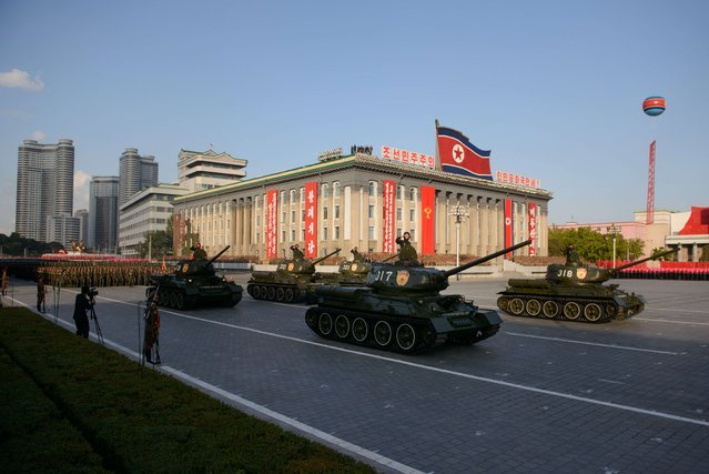 North Korean military vehicles pass through Kim Il-Sung square during a mass military parade in Pyongyang on October 10, 2015. North Korea was marking the 70th anniversary of its ruling Workers' Party. (Photo by Ed Jones/AFP Photo)