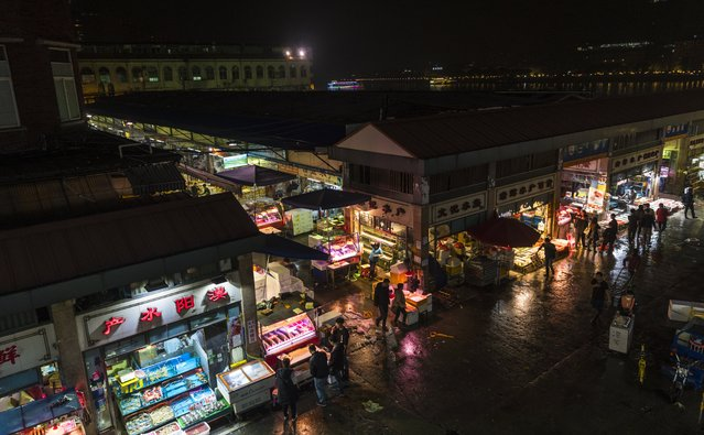 General night view of the Huangsha Seafood Market in Guangzhou, Guandong Province, China, 20 January 2018. (Photo by Aleksandar Plavevski/EPA/EFE)