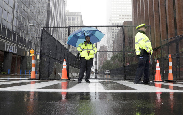Law enforcement and traffic police stand at a closed street as preparations are made for the Republican National Convention, Saturday, July 16, 2016 in Cleveland, Ohio. (Photo by Alex Brandon/AP Photo)