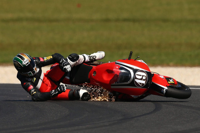 Alex Pons of Spain and the AGR team crashes during Moto2 warm up ahead of the 2015 MotoGP of Australia at Phillip Island Grand Prix Circuit on October 18, 2015 in Phillip Island, Australia. (Photo by Cameron Spencer/Getty Images)