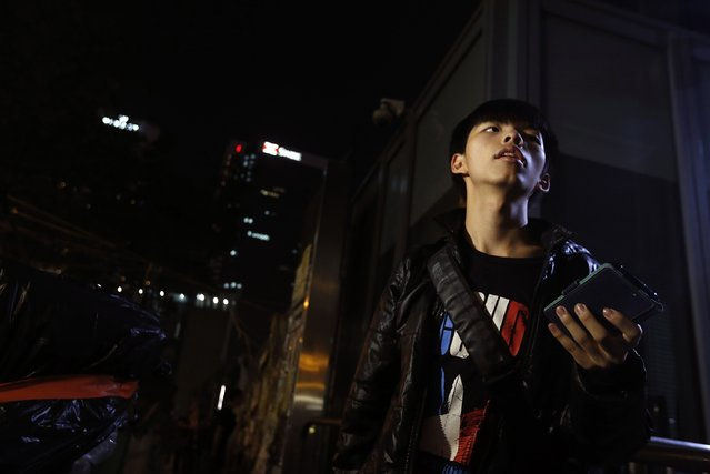 Student leader Joshua Wong stands outside the legislative council protest site in Hong Kong, November 30, 2014. Student activist groups have called for an escalation of the protests in Admiralty. Thousands of police are on standby, according to the South China Morning Post. (Photo by Bobby Yip/Reuters)
