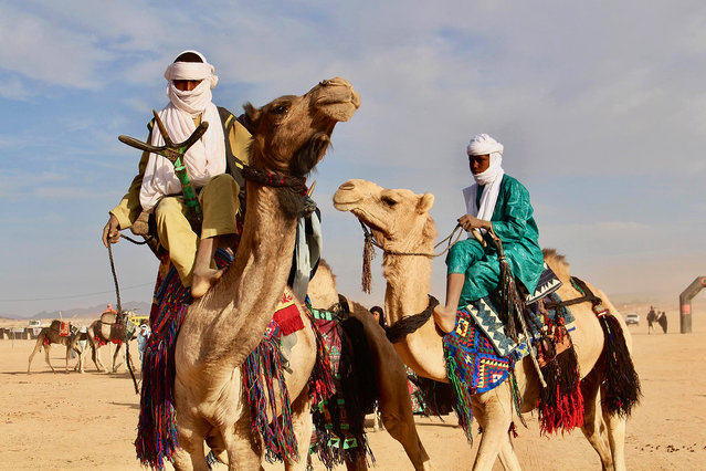 In this photo taken Sunday February 18, 2018, Tuareg men ride on camels during a festival in Iferouane, Niger. (Photo by Ludivine Laniepce/AP Photo)