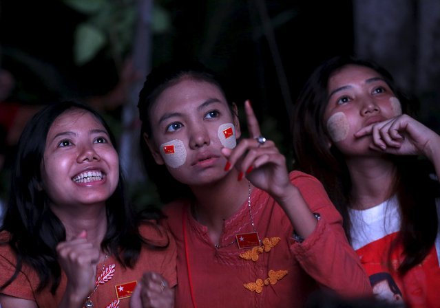 Supporters of opposition leader Aung San Suu Kyi watch results come in on a TV monitor at the National League for Democracy (NLD) offices in Mandalay, Myanmar, November 9, 2015. Myanmar's ruling party conceded defeat in the country's general election on Monday, as the opposition led by democracy figurehead Aung San Suu Kyi appeared on course for a landslide victory that would ensure it can form the next government. (Photo by Olivia Harris/Reuters)
