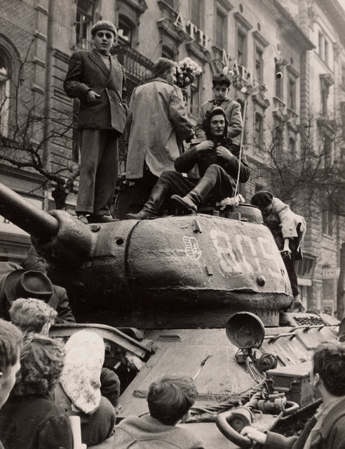 Fighters stand on top of a tank in Budapest at the time of the uprising against the Soviet-supported Hungarian communist regime in 1956. The picture was taken in the period between October 23 and November 4, 1956. (Photo by Laszlo Almasi/Reuters)