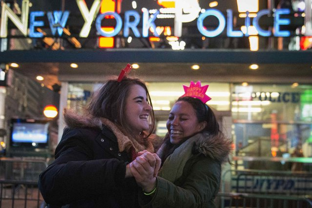 Friends dance after midnight during New Year's Eve celebrations in Times Square, New York January 1, 2015. (Photo by Stephanie Keith/Reuters)