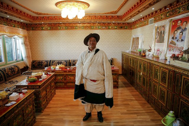 A Tibetan herdsman Lob Sang poses in his home decorated with pictures of Chinese leaders after being visited by foreign reporters on a government organised tour in Damxung county of the Tibet Autonomous Region, China November 18, 2015. (Photo by Damir Sagolj/Reuters)