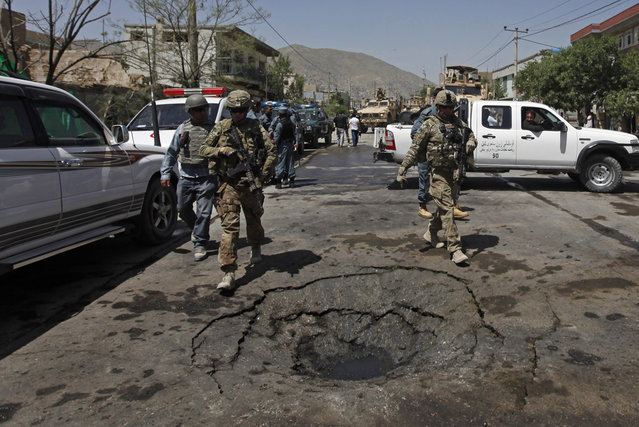 NATO soldiers with the International Security Assistance Force (ISAF) arrive at the site of a suicide attack in Kabul May 16, 2013. (Photo by Mohammad Ismail/Reuters)