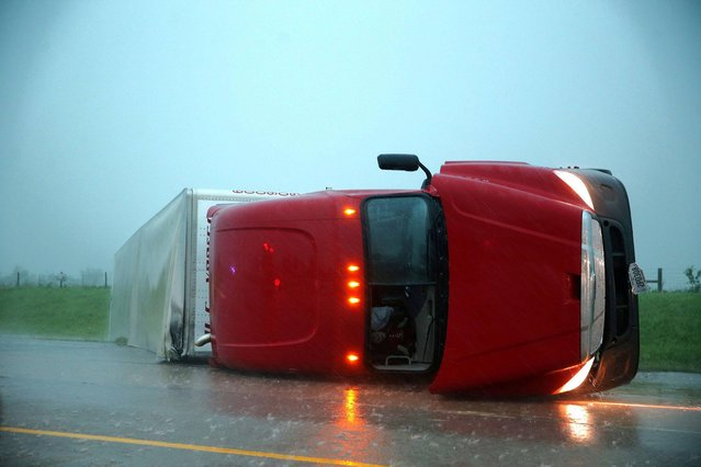 An overturned semitrailer rests on its side on the eastbound lanes of Interstate 40, just east of El Reno, Okla., after a reported tornado touched down, Friday, May 31, 2013. (Photo by Chris Machian/AP Photo/Omaha World-Herald)