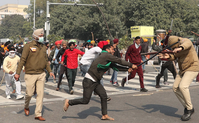 Indian farmers clash with the police near the police headquarter in New Delhi, India, 26 January 2021. Farmers organized a 'parallel parade' to counter India's Republic Day parade in New Delhi on the same day and fought through police barricades and tear gas to enter Delhi's historic Red Fort complex and also near the police headquater and in parts of centreal Delhi. (Photo by Harish Tyagi/EPA/EFE)
