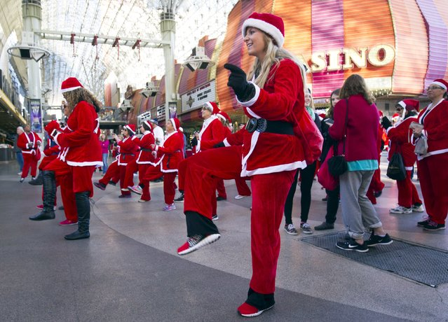 Runner Misty Grimm warms up before the 11th annual Las Vegas Great Santa Run in downtown Las Vegas, Nevada, December 5, 2015. The Las Vegas run competes with a run in Liverpool, England to see who can gather the largest number of Santas. (Photo by Steve Marcus/Reuters)
