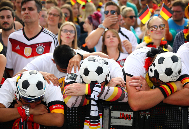 Crowds of Germany supporters react to the World Cup game against South Korea on June 27, 2018 at a public viewing area at Brandenburg Gate in Berlin, Germany. (Photo by Hannibal Hanschke/Reuters)