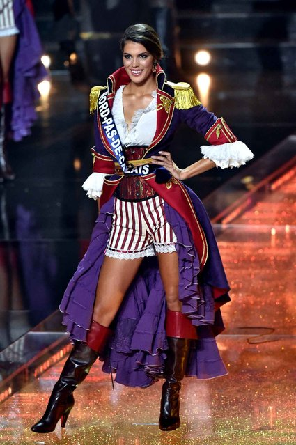 Miss Nord-Pas-de-Calais Iris Mittenaere stands on stage during the Miss France 2016 beauty pageant, on December 19, 2015 in Lille, northern France. (Photo by Philippe Huguen/AFP Photo)