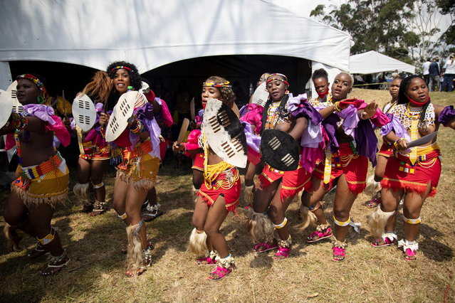 Zulu maidens dance during the memorial service for King Goodwill Zwelithini in Nongoma, South Africa, March 18, 2021. King Goodwill Zwelithini died on March 12, 2021 in the eastern city of Durban, aged 72, after weeks of treatment for a diabetes-related illness. (Photo by Phill Magakoe/Pool via Reuters)