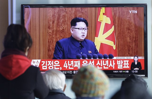 """South Koreans watch a TV news program showing North Korean leader Kim Jong Un's New Year speech, at the Seoul Railway Station in Seoul, South Korea, Friday, January 1, 2016. Kim said in an annual New Year speech that he's ready for war if provoked by """"invasive"""" outsiders but stayed away from past threats centering on the country's nuclear weapons and long-range missile ambitions The letters read: """"Kim Jong Un's New Year Speech"""". (Photo by Ahn Young-joon/AP Photo)"""