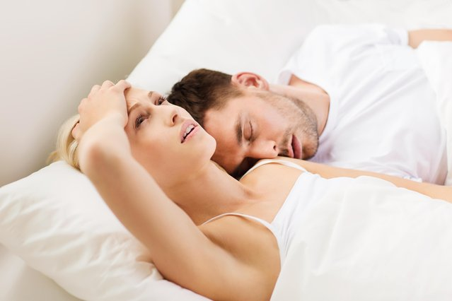 Couple sleeping in bed at home. (Photo by Lev Dolgachov/Alamy Stock Photo)