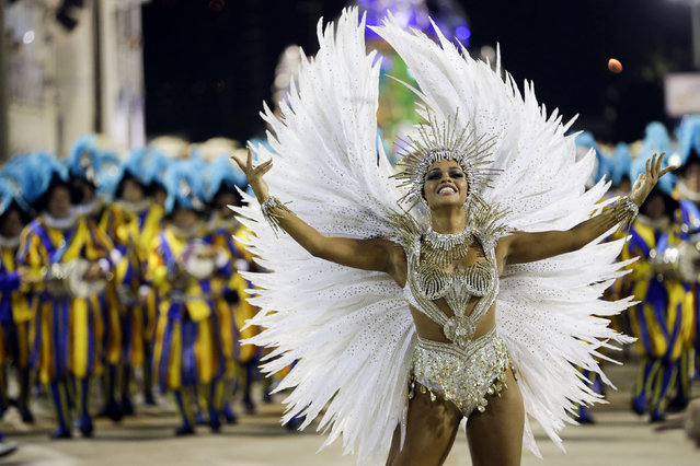 Drum queen Juliana Alves from the Unidos da Tijuca samba school parades during carnival celebrations at the Sambadrome in Rio de Janeiro, Brazil, Tuesday, February 17, 2015. (Photo by Felipe Dana/AP Photo)