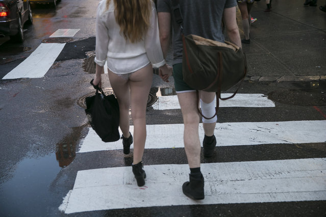 A young couple participating in the No Pants Subway Ride head towards Union Square Station in New York City, Sunday, January 10, 2016. (Photo by Gordon Donovan/Yahoo News)