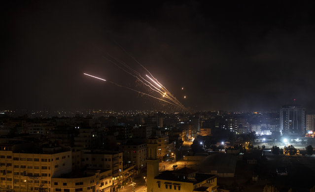 Rockets are launched from the Gaza Strip towards Israel, Wednesday, May 12, 2021. (Photo by Khalil Hamra/AP Photo)