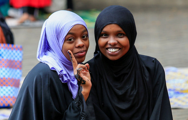Muslims pose for a photograph after performing the Eid prayers, amid the coronavirus disease (COVID-19) pandemic, on the first day of Eid al-Fitr, at the Masjid Noor Mosque in Nairobi, Kenya on May 13, 2021. (Photo by Monicah Mwangi/Reuters)