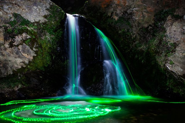 The otherworldy images are created by clever use of long exposure photography and glow sticks floating through water. (Photo by Sean Lenz/Kristoffer Abildgaard)