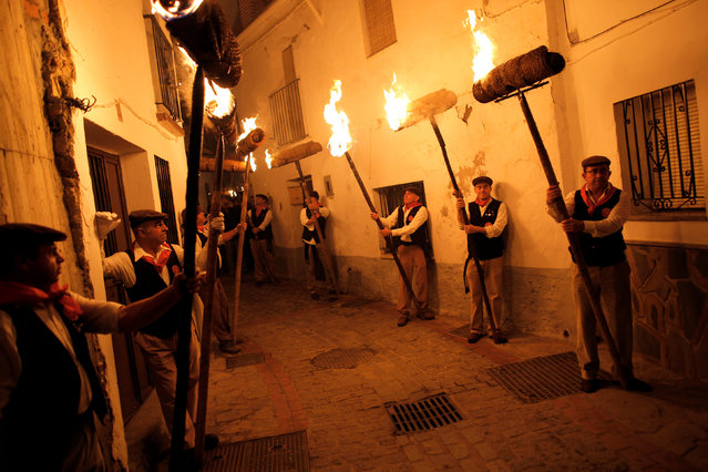 Villagers hold torches during the Divina Pastora procession, as part of a festival to honour the Virgin of Los Rondeles, in the southern Spanish village of Casarabonela, near Malaga, late December 12, 2016. Villagers celebrate the festival on the eve of St. Lucia's Day and hold torches during the procession to represent light and vision. St. Lucia is the patron saint of vision. (Photo by Jon Nazca/Reuters)