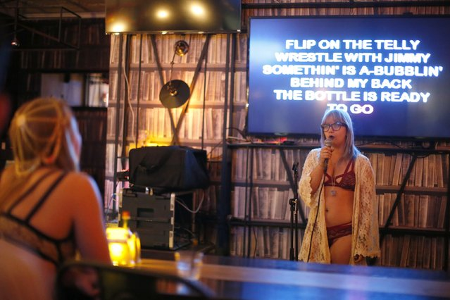 Chelsea Hughes, 25, sings at the first annual Underwear Karaoke, an event that pairs two common fears: being seen in your underwear and singing in public, in Los Angeles, California March 12, 2015. (Photo by Lucy Nicholson/Reuters)