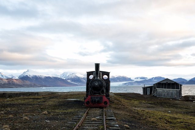An old locomotive train that was used for transporting coal is preserved as a monument at Ny-Alesund, in Svalbard, Norway, October 11, 2015. (Photo by Anna Filipova/Reuters)